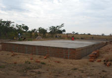 The foundation slab stands completed.