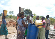 Workers carried water to the work site for use in cement and building.