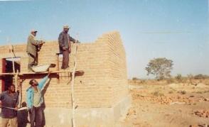 Scaffolding work progress as walls are built.