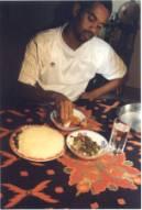 The traditional method of eating nshima.