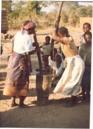 Zambian women preparing food.